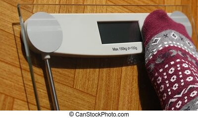 Man Weighing With Bathroom Scale - Man stepping on bathroom...