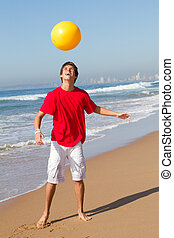 playful teen boy - a playful teenage boy on the beach...