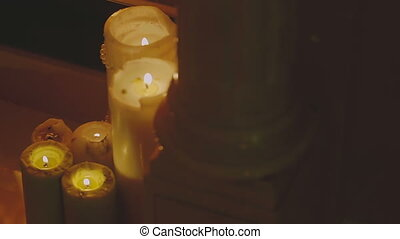 Warm Candles gently burning near by fireplace
