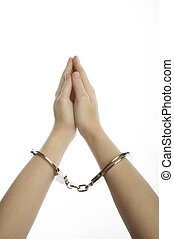 Hands and handcuffs isolated on white background