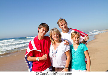 happy american family - a happy american family of four on...