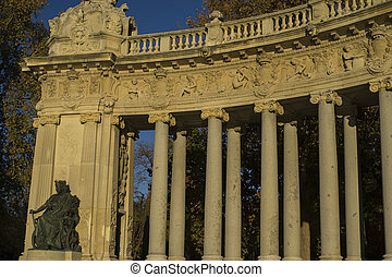 Stone monument with Ionic columns in the Jardin del Retiro...