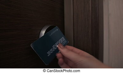female unlock hotel door using electron keycard - Hotel door...