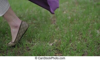 Young Women's Feet Run Through the Summer Grass. Feamle in...
