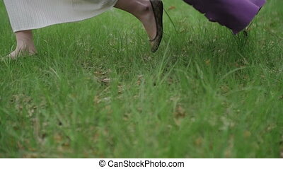Womens Feet Run Through the Park Outdoor - Young Womens Feet...