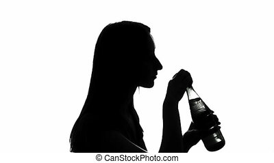 Woman drinking water - Silhouette of a woman drinking water,...