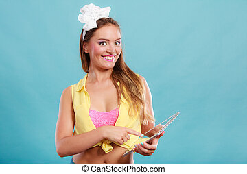 Pin up fashion girl browsing internet on pc tablet - Young...