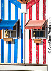 Colorful, striped, fishermen's, houses, in, blue, and, red,...