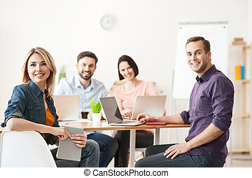 Skillful four colleagues are expressing positive emotions -...