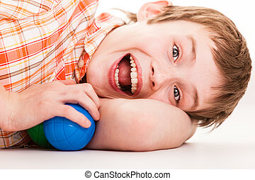 Exuberant child laying on side - Close up on single...