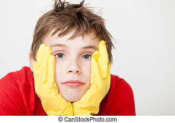 Bored child in gloves with hands on face - Bored single...