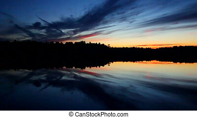 Northern Wisconsin Sunset - Still waters under a subdued...