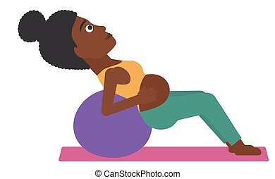 Pregnant woman on gymnastic ball - An african-american...