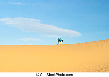 Male Photographer in Death Valley dunes