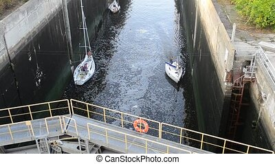 Two beautiful yachts or boats in sluice with closed iron...