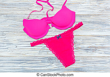 bra and panties pink on the aged boards