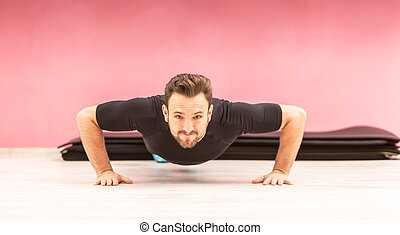 Portrait of a Young Man Doing Pushups