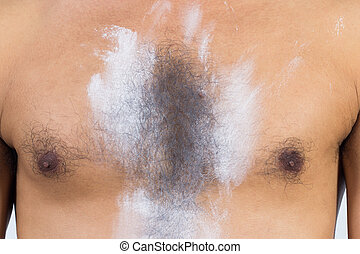 Close up hairy's man chest dredge powder