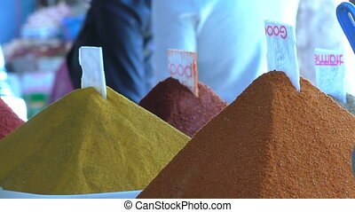Piles traditional Moroccan spices - Close up of colourful...