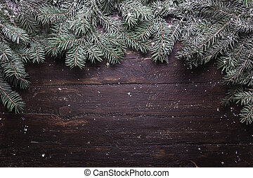 Christmas and New Year decoration composition. Top view of fur-tree branches on wooden background with place for your text