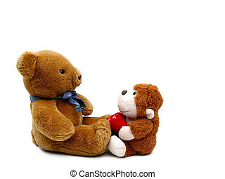 Stuffed monkey animal and stuffed teddy bear facing eachother isolated on white
