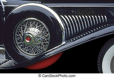 Wheel and grill - Spare wheel and tire on classic automobile...