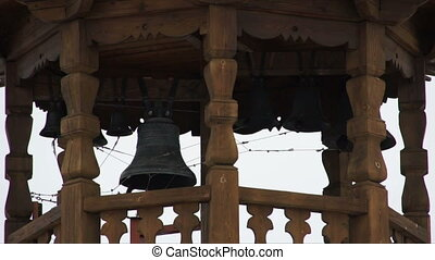 Monastery in winter - Wooden monastery buildings with bells...