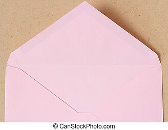 pink open envelope on wood background