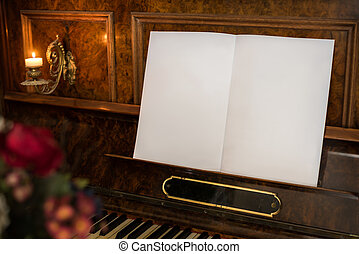 Old Piano with Open Blank Book with Copy Space