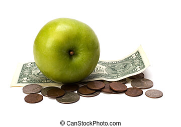 Apple and money isolated.  Health concept