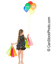 little shopper - happy girl with shopping bags and balloons...