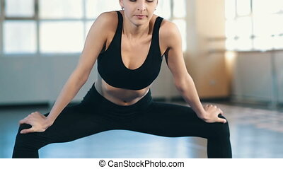 Young sportswoman stretching - Young woman do yoga indoors