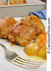 Pieces of chicken with potatoes - Fried chicken haunch with...