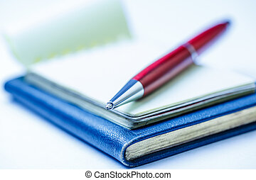 Paper blocks with pen on it in closeup