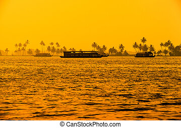 beautiful sunset landscape with houseboats at backwaters...