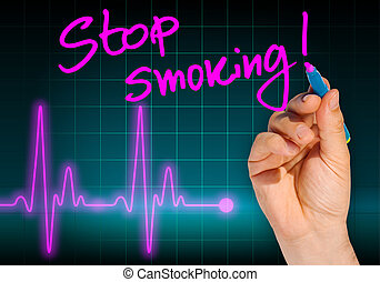 Hand writing message STOP SMOKING with heart rate monitor in...