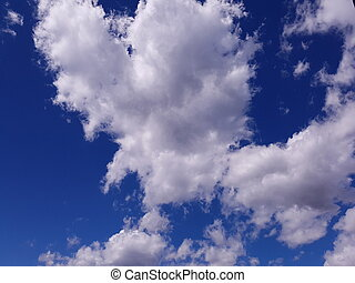 Heart-shaped cloud - Heart shaped white cloud against blue...