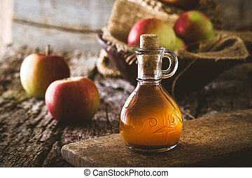 Apple vinegar. Bottle of apple organic vinegar on wooden...