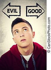 Teenage boy choosing between GOOD and EVIL - Portrait of...