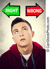 Teenage boy facing choice between RIGHT and WRONG - Portrait...