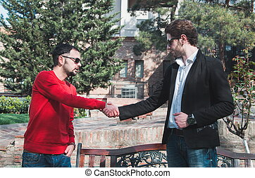 young business men shaking hands