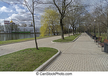 Pedestrian alley on the banks of the pond - Pedestrian alley...