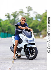 Man posing on a motorcycle at the road
