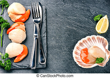 Raw queen scallops in sea food dinner setting. Food...