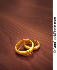 Wedding rings - Golden wedding rings engraved Forever on...