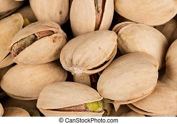 Pistachio nuts arranges as background close up