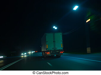truck moves on highway at night - truck moves on country...