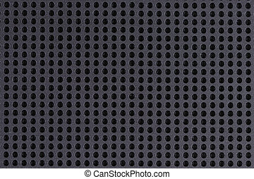 metallic grid - metal grid with some holes in it