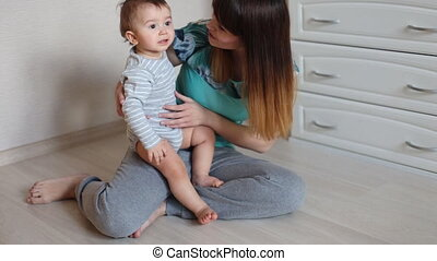 Mother and little son playing - Mom with her 2 years old...