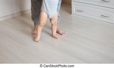 Mother and baby legs First steps - Portrait of mother and...